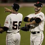 Andres Torres (left) and Cody Ross relaxed in the outfield during a change of pitchers late in the game. The San Francisco Giants defeated the Texas Rangers 11-7 in the first game of the 2010 World Series.