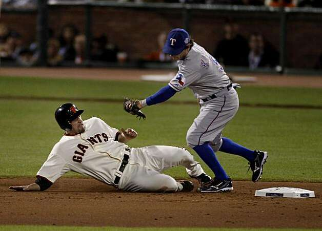 Aubrey Huff is tagged out by Elvis Andrus in the 7th inning. The San Francisco Giants defeated the Texas Rangers 11-7 in the first game of the 2010 World Series. Photo: Brant Ward, San Francisco Chronicle