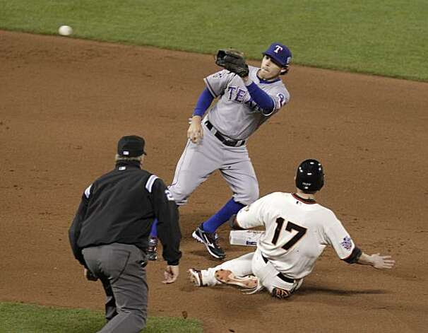 Giants Aubrey Huff is caught stealing second base by Rangers Ian Kinsler in the seventh inning as the San Francisco Giants take on the Texas Rangers in Game 1 of the World Series at AT&T Park in San Francisco, Calif., on Wednesday, October 27, 2010. Photo: Lacy Atkins, San Francisco Chronicle
