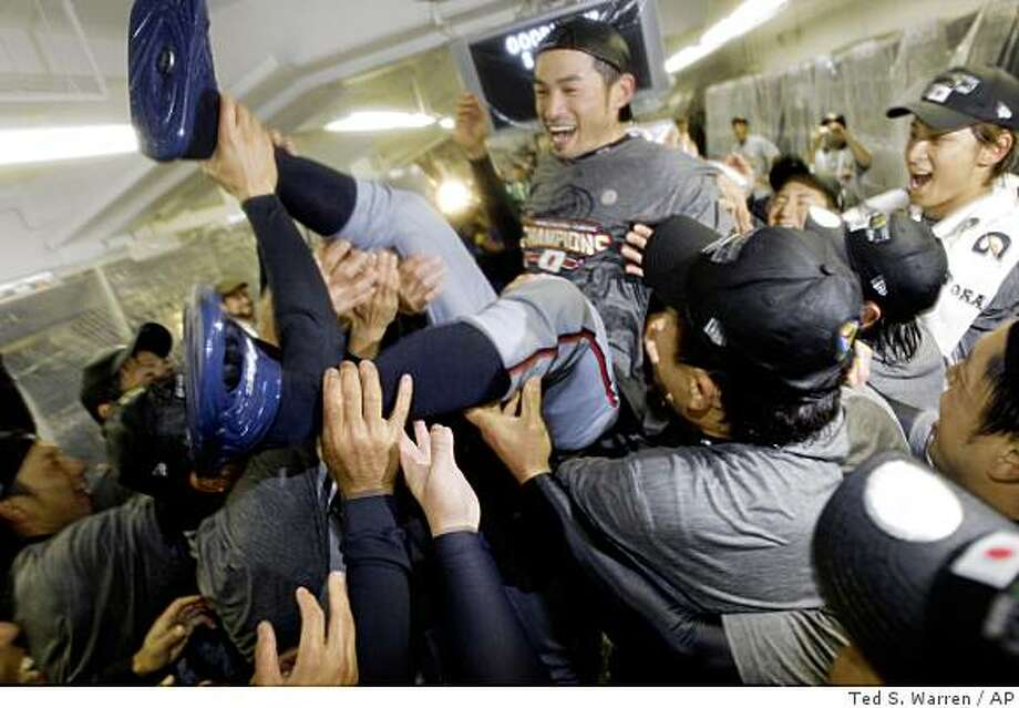 Japan's Ichiro Suzuki gets tossed around by teammates during a clubhouse celebration after their 5-3 victory over South Korea in the championship game of the World Baseball Classic Monday, March 23, 2009, in Los Angeles. Photo: Ted S. Warren, AP