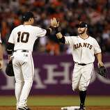 Cody Ross high fives Travis Ishikawa after the game. The San Francisco Giants played the Texas Rangers at AT&T Park in San Francisco, Calif., in Game 1 of the World Series on Wednesday, October 27, 2010. The Giants defeated the Rangers 11-7