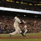 Giants Juan Uribe connects for a 3-run home run in the fifth inning as the San Francisco Giants take on the Texas Rangers in Game 1 of the World Series at AT&T Park in San Francisco, Calif., on Wednesday, October 27, 2010.