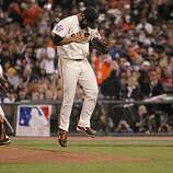 Giants relief pitcher Sergio Romo jumps off the mound as he comes out of the game in the eighthn inning, as the San Francisco Giants went on to beat the Texas Rangers 11-7 in game 1 of the Major League Baseball World Series on Wednesday Oct. 27, 2010 in San Francisco, Calif.