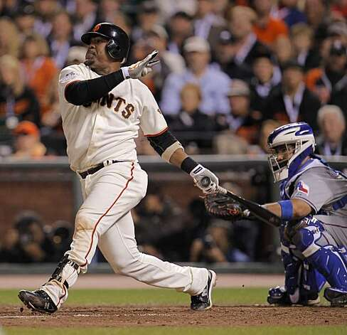 Giants Juan Uribe connects for a 3-run homer in the fifth inning, making the score 8-5, as the San Francisco Giants take on the Texas Rangers in Game 1 of the World Series at AT&T Park in San Francisco, Calif., on Wednesday, October 27, 2010. Photo: Michael Macor, The Chronicle