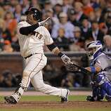 Giants Juan Uribe connects for a 3-run homer in the fifth inning, making the score 8-5, as the San Francisco Giants take on the Texas Rangers in Game 1 of the World Series at AT&T Park in San Francisco, Calif., on Wednesday, October 27, 2010.