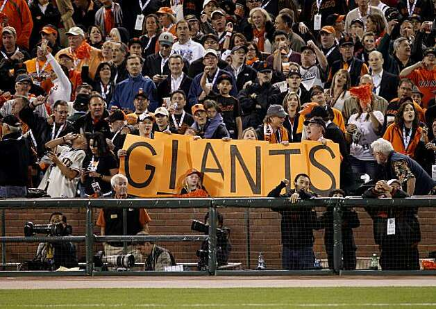 Fans make it clear who they are rooting for in the 7th inning. The San Francisco Giants defeated the Texas Rangers 11-7 in the first game of the 2010 World Series. Photo: Brant Ward, San Francisco Chronicle