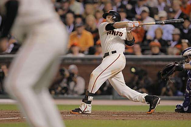 Giants Freddy Sanchez doubles to deep center, Andres Torres scores in the fifth innin  as the San Francisco Giants take on the Texas Rangers in Game 1 of the World Series at AT&T Park in San Francisco, Calif., on Wednesday, October 27, 2010. Photo: Michael Macor, San Francisco Chronicle