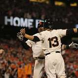 Giants Juan Uribe is greeted at the plate by Cody Ross and Aubrey Huff after hitting a 3-run home run in the fifth inning as the San Francisco Giants take on the Texas Rangers in Game 1 of the World Series at AT&T Park in San Francisco, Calif., on Wednesday, October 27, 2010.