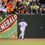 Rangers Nelson Cruz chases Freddy Sanchez's double in the fifth as the San Francisco Giants take on the Texas Rangers in Game 1 of the World Series at AT&T Park in San Francisco, Calif., on Wednesday, October 27, 2010.