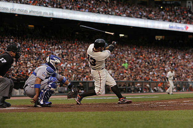 Giants Cody Ross loses his bat on a swing in the second inning as the San Francisco Giants take on the Texas Rangers in Game 1 of the World Series at AT&T Park in San Francisco, Calif., on Wednesday, October 27, 2010. Photo: Carlos Avila Gonzalez, San Francisco Chronicle