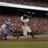 Giants Cody Ross loses his bat on a swing in the second inning as the San Francisco Giants take on the Texas Rangers in Game 1 of the World Series at AT&T Park in San Francisco, Calif., on Wednesday, October 27, 2010.