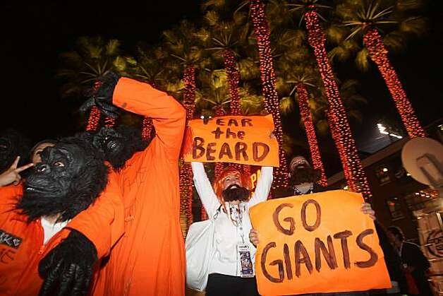 Game one of the World Series between the San Francisco Giants and the Texas Rangers at AT&T park. Giant's fans celebrate at King and Third streets after an 11 to 7 win over the Texas Rangers in San Francisco, Calif., on Wednesday, October 27, 2010. Photo: Liz Hafalia, San Francisco Chronicle