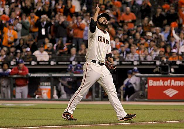 Giants relief pitcher Sergio Romo points skyward as he comes out of the game in the eighthn inning, as the San Francisco Giants went on to beat the Texas Rangers 11-7 in game 1 of the Major League Baseball World Series on Wednesday Oct. 27, 2010 in San Francisco, Calif. Photo: Michael Macor, San Francisco Chronicle