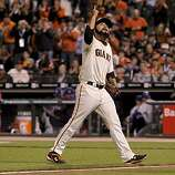 Giants relief pitcher Sergio Romo points skyward as he comes out of the game in the eighthn inning, as the San Francisco Giants went on to beat the Texas Rangers 11-7 in game 1 of the Major League Baseball World Series on Wednesday Oct. 27, 2010 in San Francisco, Calif.