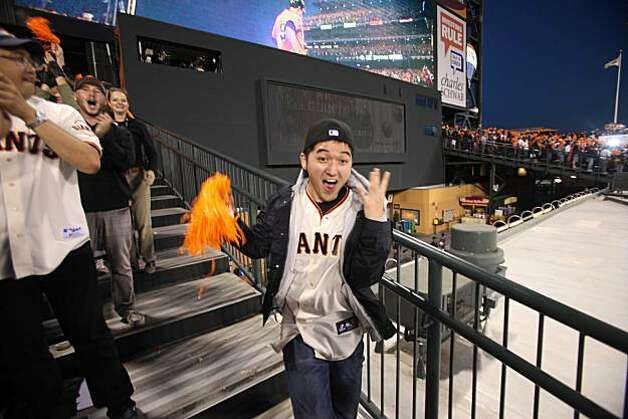 Grant Mizuna runs up and down the bleachers after Giants Pat Burrell hit a 3 run homer in the 1st the playoff game against the Atlanta Braves on Friday Oct. 7, 2010 in San Francisco, Calif. Photo: Mike Kepka, The Chronicle