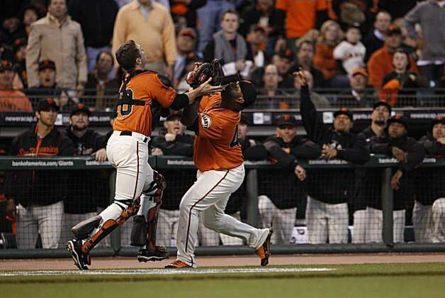 Giants Buster Posey, left, and Pablo Sandoval collide while chasing a pop fly hit by Braves Jason Heyward in the top of the first inning as the San Francisco Giants take on the Atlanta Braves  in Game 2 of the National League Division Series at AT&T Park in San Francisco, Calif., on Friday, October 8, 2010. Photo: Carlos Avila Gonzalez, The Chronicle