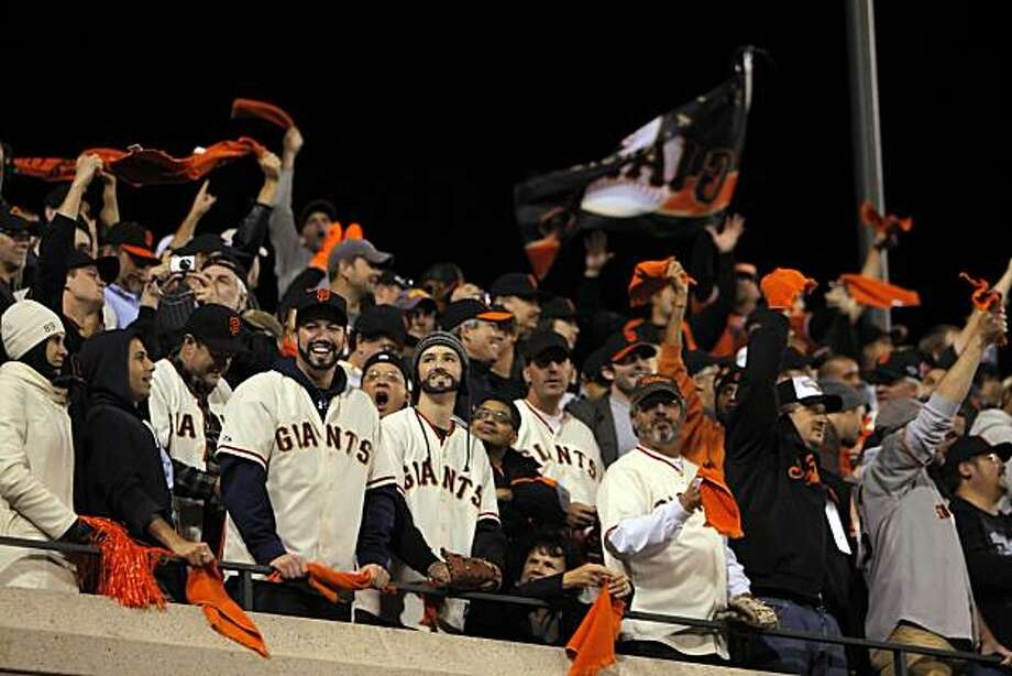 Giants fans celebrate during the team's 7-run eighth inning. The San Francisco Giants played the Texas Rangers at AT&T Park in San Francisco, Calif., in Game 2 of the World Series on Thursday, October 28, 2010. The Giants defeated the Rangers 9-0, largely on a 7 run eighth inning. Photo: Carlos Avila Gonzalez, The Chronicle