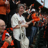 Jerry Lerman (left) and his wife Eve Lerman (right) cheer during  game one of the World Series in San Francisco, Calif., on Thursday, October 28, 2010