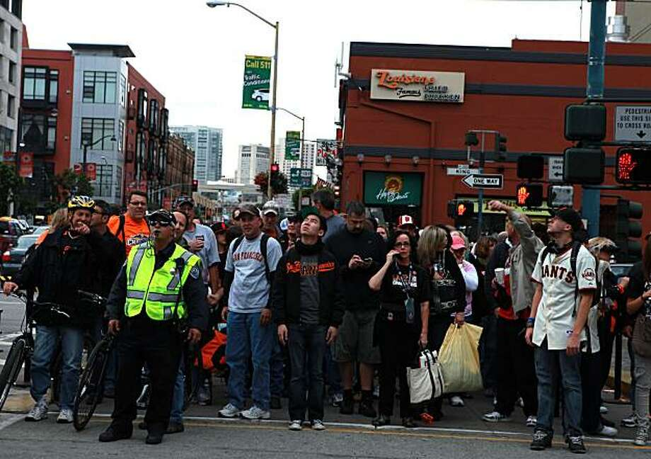 Fans wait to cross King street outside of AT&T park just before  game two of the World Series in San Francisco, Calif., on Thursday, October 28, 2010 Photo: Liz Hafalia, The Chronicle