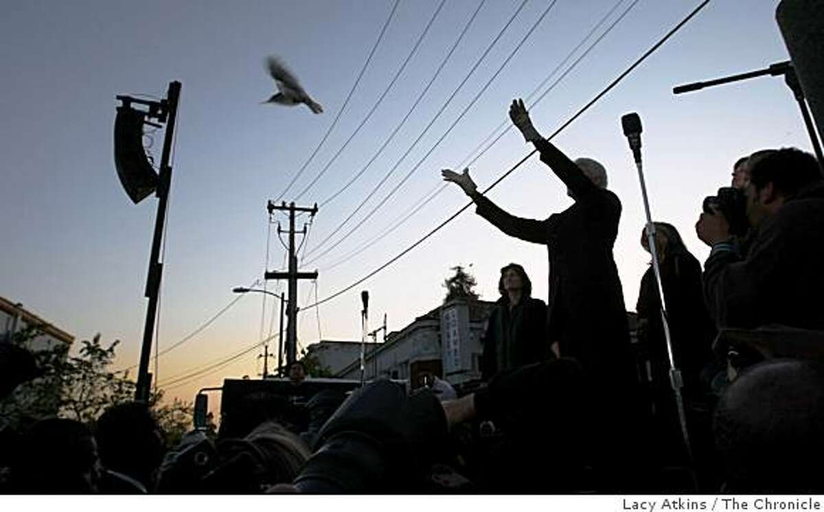 Oakland Mayor Ron Dellums releases a dove over the crowd at the vigil for the slain police officers.