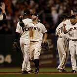 Giants players including Cody Ross (center) celebrate at the end of the game. The San Francisco Giants defeated the Texas Rangers 9-0 in game 2 of the 2010 World Series.