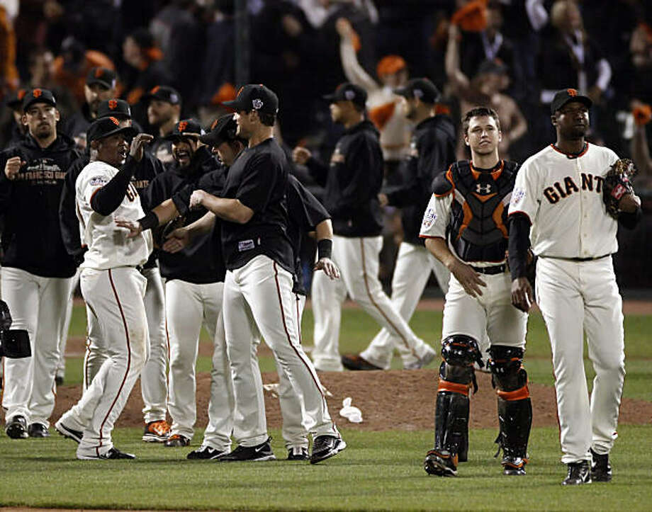 The San Francisco Giants celebrate at the end of the game after defeating the Rangers in Game 2. The Giants played the Texas Rangers at AT&T Park in San Francisco, Calif., in Game 2 of the World Series on Thursday, October 28, 2010. The Giants defeated the Rangers 9-0, largely on a 9 run eighth inning. Photo: Carlos Avila Gonzalez, San Francisco Chronicle