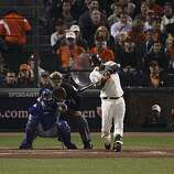 Giants Edgar Renteria hits a solo home run in the fifth inning to give the Giants a 1-0 lead as the San Francisco Giants take on the Texas Rangers in Game 2 of the World Series at AT&T Park in San Francisco, Calif., on Thursday, October 28, 2010.