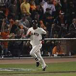 Giants Edgar Renteria watches the flight of his solo home run in the fifth inning as the San Francisco Giants take on the Texas Rangers in Game 2 of the World Series at AT&T Park in San Francisco, Calif., on Thursday, October 28, 2010.