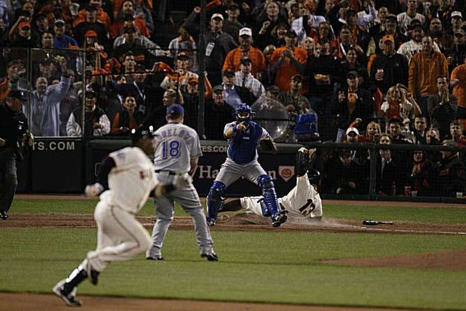 Cody Ross scores on a Juan Uribe single in the seventh. Uribe took second on the throw and was safe as the San Francisco Giants take on the Texas Rangers in Game 2 of the World Series at AT&T Park in San Francisco, Calif., on Thursday, October 28, 2010. Photo: Carlos Avila Gonzalez, San Francisco Chronicle