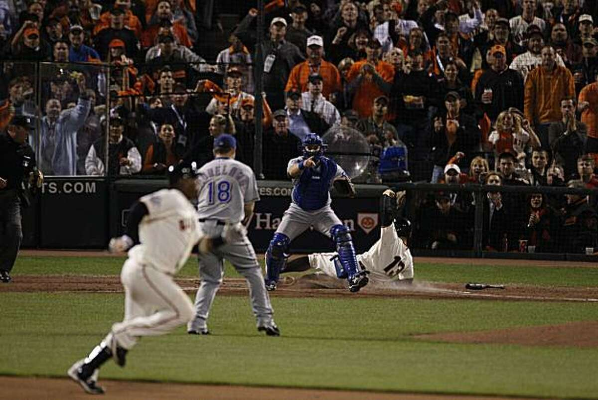 Cody Ross scores on a Juan Uribe single in the seventh. Uribe took second on the throw and was safe as the San Francisco Giants take on the Texas Rangers in Game 2 of the World Series at AT&T Park in San Francisco, Calif., on Thursday, October 28, 2010.