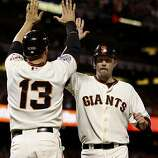 Cody Ross welcomed Aubrey Huff in the 8th inning after both scored on Edgar Renteria's single. The San Francisco Giants defeated the Texas Rangers 9-0 in game 2 of the 2010 World Series.