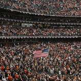 A fan waves the American flag during the National Anthem.  The San Francisco Giants take on the Texas Rangers in Game 2 of the World Series at AT&T Park in San Francisco, Calif., on Thursday, October 28, 2010.