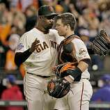 San Francisco Giants pitcher Guillermo Mota and catcher Buster Posey congratulate each other after defeating the Texas Rangers in 9-0 in Game 2 of the World Series, Thursday Oct. 27, 2010, at AT&T Park in San Francisco, Calif.