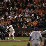 Giants Juan Uribe hits a single, scoring Cody Ross, to give the Giants a 2-0 lead in the seventh as the San Francisco Giants take on the Texas Rangers in Game 2 of the World Series at AT&T Park in San Francisco, Calif., on Thursday, October 28, 2010.