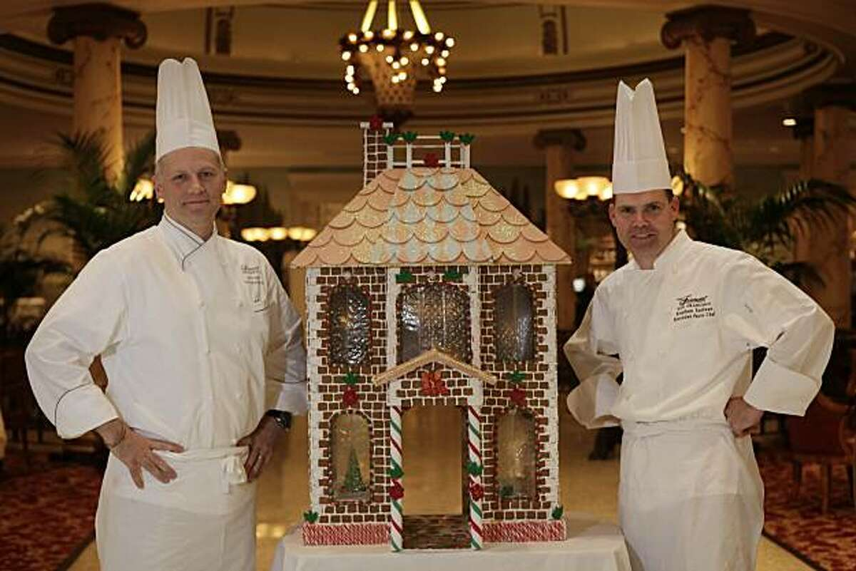 j.W.Forester (lto r), Fairmont executive chef and Stephen Sullivan, Fairmont executive pastry chef, are seen with a scale model of the gingerbread house which will be built as full size in November at the entrance to the Fairmont Laurel Court Restaurant & Bar on Friday, October 8, 2010 in San Francisco, Calif.