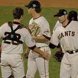Matt Cain, (center) is congratulated as he comes out in the eighth inning by Buster Posey and Freddy Sanchez, as the San Francisco Giants take game 2, with a score of 9-0 over the Texas Rangers during the 2010 World Series on Thursday Oct. 28, 2010 in San Francisco, Calif.
