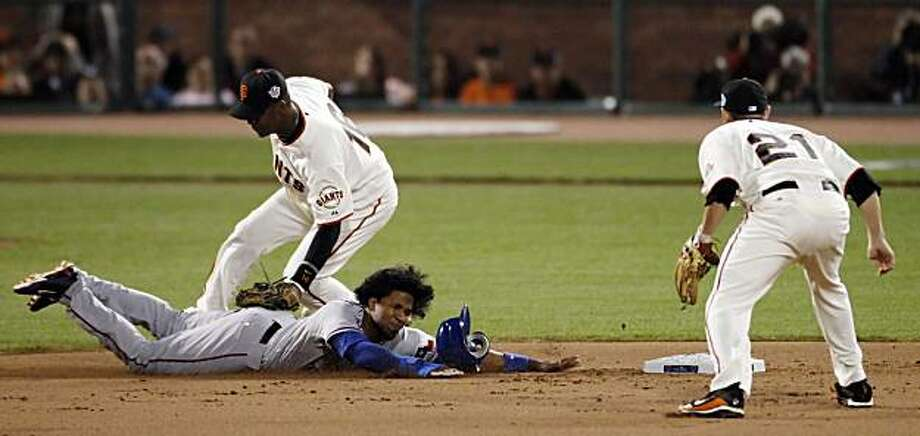 The Rangers' Elvis Andrus steals second as Edgar Renteria couldn't keep the ball in his glove in the top of the eighth inning. Andrus was stranded on second. The San Francisco Giants played the Texas Rangers at AT&T Park in San Francisco, Calif., in Game 2 of the World Series on Thursday, October 28, 2010. The Giants defeated the Rangers 9-0, largely on a 7 run eighth inning. Photo: Carlos Avila Gonzalez, San Francisco Chronicle