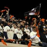 Giants fans celebrate during the team's 7-run eighth inning. The San Francisco Giants played the Texas Rangers at AT&T Park in San Francisco, Calif., in Game 2 of the World Series on Thursday, October 28, 2010. The Giants defeated the Rangers 9-0, largely on a 7 run eighth inning.