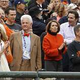 San Francisco Mayor Gavin Newsom, behind Giants owner Bill Neukom, and Speaker of the House Nancy Pelosi in the stands before the game.  The San Francisco Giants take on the Texas Rangers in Game 2 of the World Series at AT&T Park in San Francisco, Calif., on Thursday, October 28, 2010.