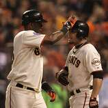 Giants Edgar Renteria is greeted by Andres Torres after hitting a home run in the fifth inning as the San Francisco Giants take on the Texas Rangers in Game 2 of the World Series at AT&T Park in San Francisco, Calif., on Thursday, October 28, 2010.