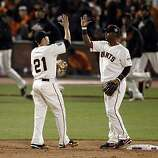Freddy Sanchez and Edgar Renteria high five at the end of the Giants' victory over the Rangers. The San Francisco Giants played the Texas Rangers at AT&T Park in San Francisco, Calif., in Game 2 of the World Series on Thursday, October 28, 2010. The Giants defeated the Rangers 9-0, largely on a 7 run eighth inning.