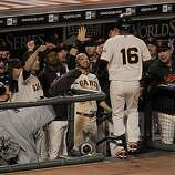 Giants Edgar Renteria is greeted by the dugout after his solo home run in the fifth inning as the San Francisco Giants take on the Texas Rangers in Game 2 of the World Series at AT&T Park in San Francisco, Calif., on Thursday, October 28, 2010.