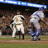 Giants Cody Ross scores in the seventh inning as the San Francisco Giants take on the Texas Rangers in Game 2 of the World Series at AT&T Park in San Francisco, Calif., on Thursday, October 28, 2010.