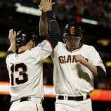 Cody Ross welcomed Aubrey Huff after they both scored in the 8th inning off Edgar Renteria's single. The San Francisco Giants defeated the Texas Rangers 9-0 in game 2 of the 2010 World Series.