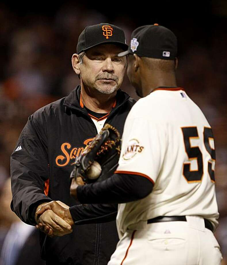 Giants manager Bruce Boche congraulates Guillermo Mota for his performance. The San Francisco Giants defeated the Texas Rangers 9-0 in game 2 of the 2010 World Series. Photo: Brant Ward, San Francisco Chronicle