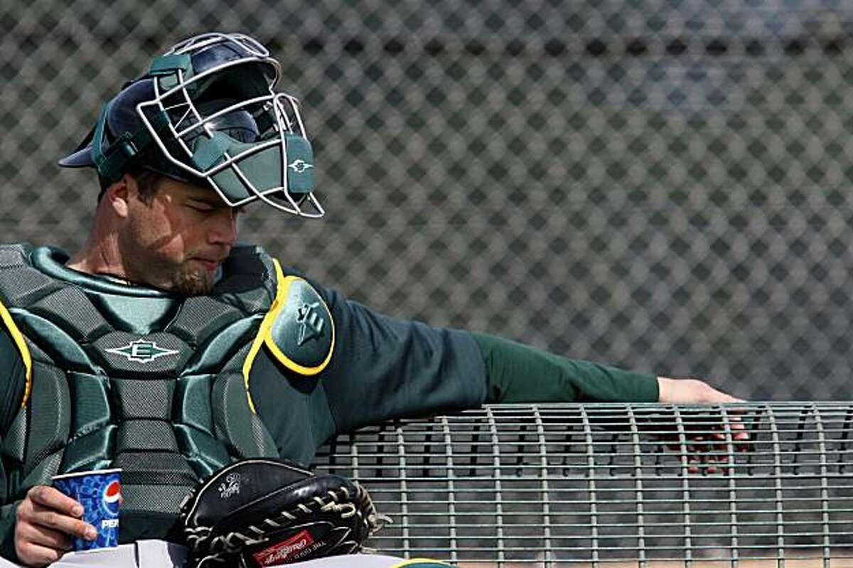 Oakland Athletics catcher Landon Powell takes a break while waiting for a new group of pitchers to arrive at Spring Training workouts at the Papago Baseball Facility Sunday February 15, 2009 in Phoenix Arizona