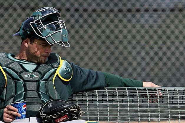 Oakland Athletics catcher Landon Powell takes a break while waiting for a new group of pitchers to arrive at Spring Training workouts at the Papago Baseball Facility Sunday February 15, 2009 in Phoenix Arizona Photo: Lance Iversen, The Chronicle