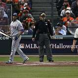 Rangers Nelson Cruz looks back at pitcher Matt Cain after striking out swinging in the second inning as the San Francisco Giants take on the Texas Rangers in Game 2 of the World Series at AT&T Park in San Francisco, Calif., on Thursday, October 28, 2010.