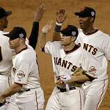 Giants close out the ninth inning, Guierllmo Mota, Nate Schierholtz, Freddy sanchez, Edgar Renteria and Aubrey Huff celebrate the win,  as the San Francisco Giants take game 2, with a score of 9-0 over the Texas Rangers during the 2010 World Series on Thursday Oct. 28, 2010 in San Francisco, Calif.