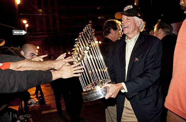Bill Neukom holds the World Series trophy while showing it to fans who gathered early in the morning to welcome the Giants home outside AT&T Park in San Francisco, Calif., on Tuesday, November 2, 2010. Photo: Laura Morton, Special To The Chronicle